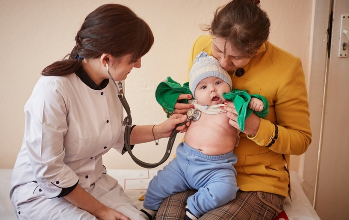 """(right) Halyna Yarych, 43, watches Dr. Nataliya Seredyuk checking her five-month-old baby Alexander prior to administering him immunizations at the General Practice Clinic in Bohorodchany, Ivano-Frankivsk Oblast, Ukraine, Tuesday 11 April 2017.  """"Three years ago, I woke up to 5 very sick children. I panicked and went with them to the hospital where they were all admitted for one week,"""" says Halyna.  The diagnosis was whooping cough and until then, Halyna had never bothered much about vaccines.  Realising that she could have lost 5 children and indeed infected the rest, Halyna is now a regular at the General Practice Clinic.  Ukraine last year had one of the lowest routine immunization coverage rates in the world. As of December 2016, according to data from Ukraine's Ministry of Health, only 45.5% of children in Ukraine were fully immunized against measles, only 29%, against hepatitis B, and only 23% of against diphtheria, pertussis and tetanus. About 60% of children under one-year are fully immunized against polio. A number of factors have contributed to the decline in vaccination coverage in Ukraine over the past years, including distrust by the public and media of vaccines and immunization services. Additionally, a shortage of vaccine supplies compounded critically low immunization rates. To address this, at the request of the Ministry of Health of Ukraine, UNICEF procured a number of high quality certified vaccines to protect children against dangerous vaccine-preventable diseases."""