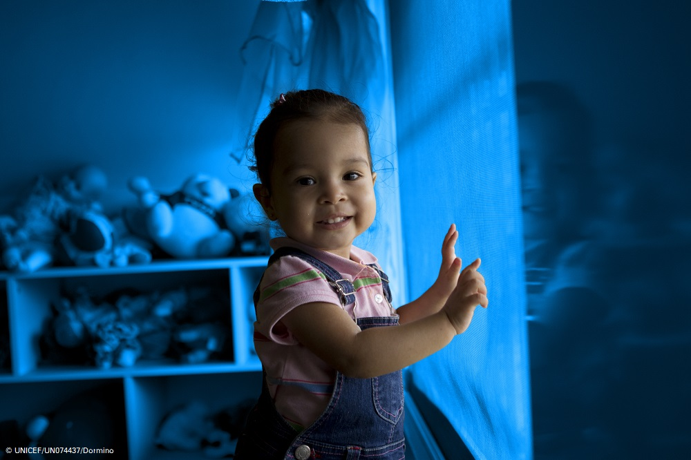 [TREATED PHOTO] Twenty-two-month-old Maria Luisa Jaen stands near a window in Hogar San José de Malambo, a residential care centre in the town of Cerro Silvestre, Arraiján District, in Panama Province. Her mother abandoned Maria Luisa at a hospital when she was 28 days old, and authorities from the National Secretariat for Children, Adolescents and Families (its Spanish acronym is SENNIAF) placed her in the centre. After a year passed without locating Maria Luisa's mother or other relatives, the Court for Children and Adolescents began the process of securing her adoption with an interested family. However, her grandparents were located one month ago; they had been unaware of their daughter's pregnancy, which was later found to be the result of rape. Encouraged by her parents, Maria Luisa's mother, who is now receiving psychosocial support, has initiated the process to reunite with her daughter. Because approval of the reunification is still pending, Maria Luisa remains at the centre, where her grandparents visit her weekly. The centre is run by the Society of the Daughters of Charity of Saint Vincent de Paul, an international Catholic NGO. Nearly 150 children – girls up to age 18 and boys up to age 8 – currently live there, where support includes education, healthcare and psychosocial assistance. [#1 IN SEQUENCE OF TWO] In November 2012 in Panama, UNICEF is working with the Government to support optimum alternative care for children at risk or who are deprived of parental care. Efforts are particularly focused on establishing for these children alternatives to institutionalization, which poses a significant threat to their rights and well-being. An estimated 2,193 Panamanian children presently live in institutions, while the figure for all Latin America and the Caribbean is conservatively approximated at 240,000. Institutionalization significantly hampers child development: As a general rule, for every three months spent in an institution, children los