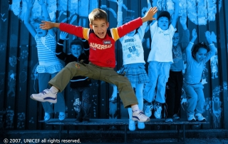 [TREATED PHOTO] In 2007 in Romania, children jump in a playground in Bucharest, the capital.  The United Nations Children's Fund (UNICEF) is one of the most trusted names in international development and humanitarian action, with a presence in over 190 countries and territories. That trust has been earned over the course of over 70 years by delivering and renewing a promise made to promote the rights and well-being of every child, everywhere. UNICEF's brand is a strategic asset that improves the organization's ability to fulfill its mission.  It builds goodwill among UNICEF supporters, improves recognition among our audiences and strengthens our reputation with partners, aiding in the building of three key brand attributes - trust. respect and high visibility.  [TREATED PHOTO] may be used for editorial use & fundraising use by UNICEF in editorial contexts in digital or traditional platforms such as UNICEF publications and global, COs, ROs and National Committee digital or traditional platforms to advocate, raise awareness and fundraise in digital campaigns and appeals. [RELEASE OBTAINED] photographs may additionally be used by UNICEF in advertising/promoting its brand eg. outdoor/indoor billboards, airport posters, bus shelter posters etc.