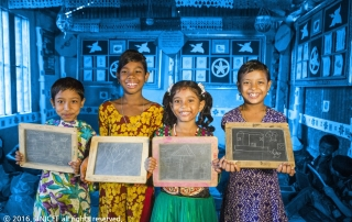 [TREATED PHOTO] Children displaying drawing work on their slate board during a class on 8 August 2016 at the UNICEF-supported Bamoyl BRAC pre-primary school in Demra, Dhaka.  The United Nations Children's Fund (UNICEF) is one of the most trusted names in international development and humanitarian action, with a presence in over 190 countries and territories. That trust has been earned over the course of over 70 years by delivering and renewing a promise made to promote the rights and well-being of every child, everywhere. UNICEF's brand is a strategic asset that improves the organization's ability to fulfill its mission. It builds goodwill among UNICEF supporters, improves recognition among our audiences and strengthens our reputation with partners, aiding in the building of three key brand attributes - trust. respect and high visibility. [TREATED PHOTO] may be used for editorial use & fundraising use by UNICEF in editorial contexts in digital or traditional platforms such as UNICEF publications and global, COs, ROs and National Committee digital or traditional platforms to advocate, raise awareness and fundraise in digital campaigns and appeals. [RELEASE OBTAINED] photographs may additionally be used by UNICEF in advertising/promoting its brand eg. outdoor/indoor billboards, airport posters, bus shelter posters etc.